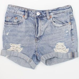 Divided distressed light wash shorts button fly